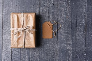 Plain wrapped Present on a rustic wo
