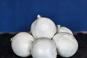White Onions And Blue Background