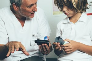 Doctor helping with an insulin pump