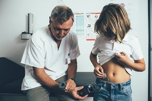 Diabetic child applies an insulin pu