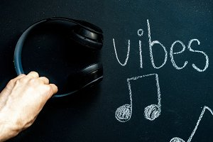 chalkboard music concept with headph
