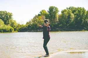 young teenager fisherman in casual c