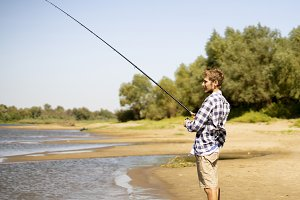 young bearded man fishing standing o