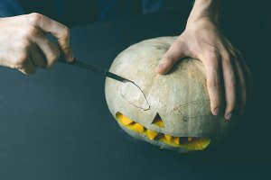 hand carving the jack o lantern out