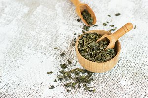 aromatic green dry tea on light