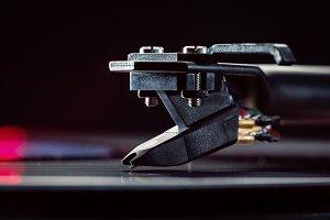 Needle on vinyl plate.
