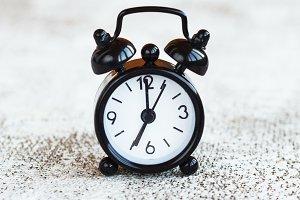 Black alarm clock on white