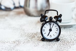 Black alarm clock on white backgroun