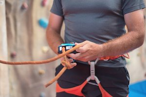 Rock wall climber wearing harness