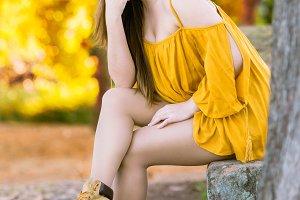 Beautiful young woman posing in autu