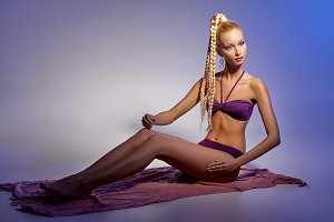 beautiful girl in bikini posing like