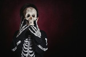 boy in skeleton costume on halloween