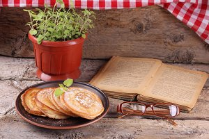 Pancakes, mint and old book