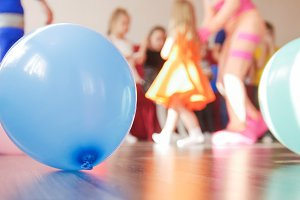 Blue balloon and group of kids on
