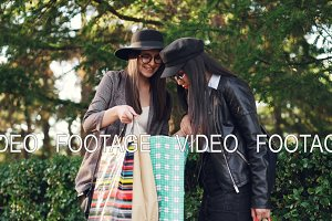 Two young women shopaholics are