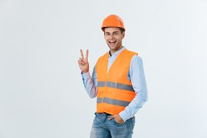 Young workman with helmet happy and