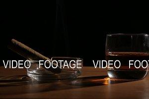Whiskey drinks with smoking cigars