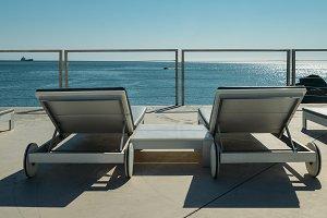 Loungers overlooking sea