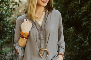 Girl smiling and modeling jewelry