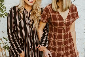 Girls smiling in fall wear
