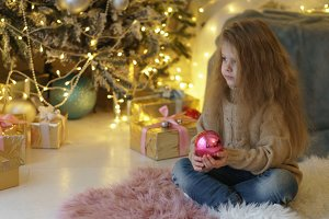 Little girl with Christmas toy.