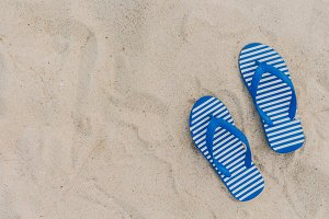 Blue flipflop  on beach sand
