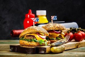 Homemade hamburgers on wooden backgr