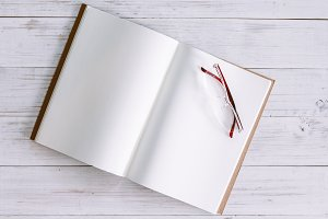 Open book with blank pages on wooden