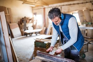 A man worker in the carpentry
