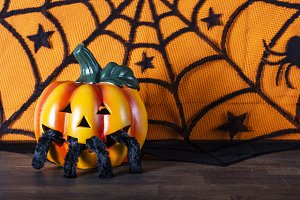 Pumpkin and spider with spider web.