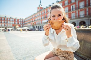 woman making smile with Empanada at