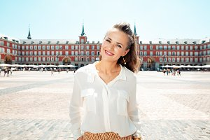 happy woman at Plaza Mayor in Madrid
