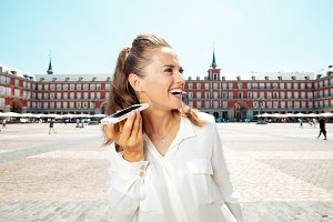 happy tourist woman listening to aud