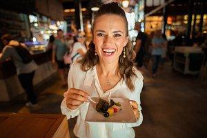 happy young woman at Mercado San Mig