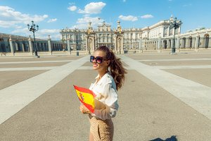 happy traveller woman with Spain fla