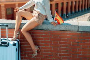 smiling elegant woman with Spain fla