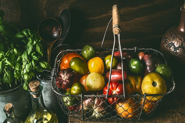 Food Stock Photos: VICUSCHKA - Colorful tomatoes in harvest basket