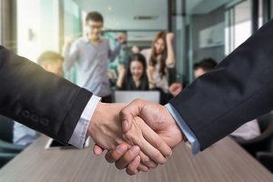 Business shaking hands of partner ov