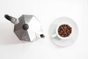 Coffee pot and roasted coffee beans