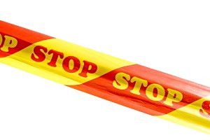 Warning tape with STOP sign isolated
