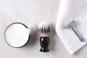 Safety razor on a towel with brush a