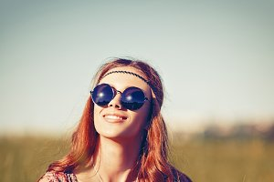 Young hippie girl in the field