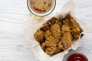Chicken wings with sauce, cold beer