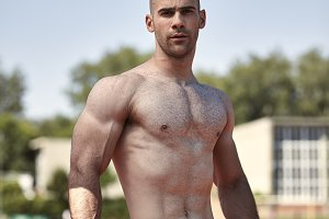 one young muscular man, outdoors pos