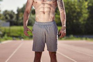 one bodybuilder shirtless, muscular