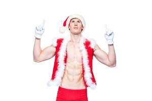 Sexy Santa Claus pointing in white