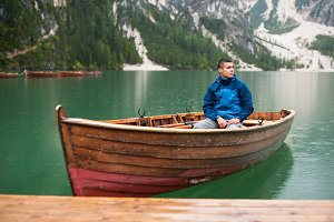 guy who is in the boat