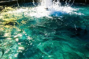 Fountain on photo with lot of water