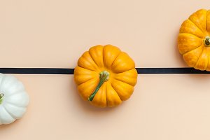 Fall background with small pumpkins
