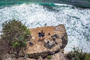 Aerial shot of couple on the cliff